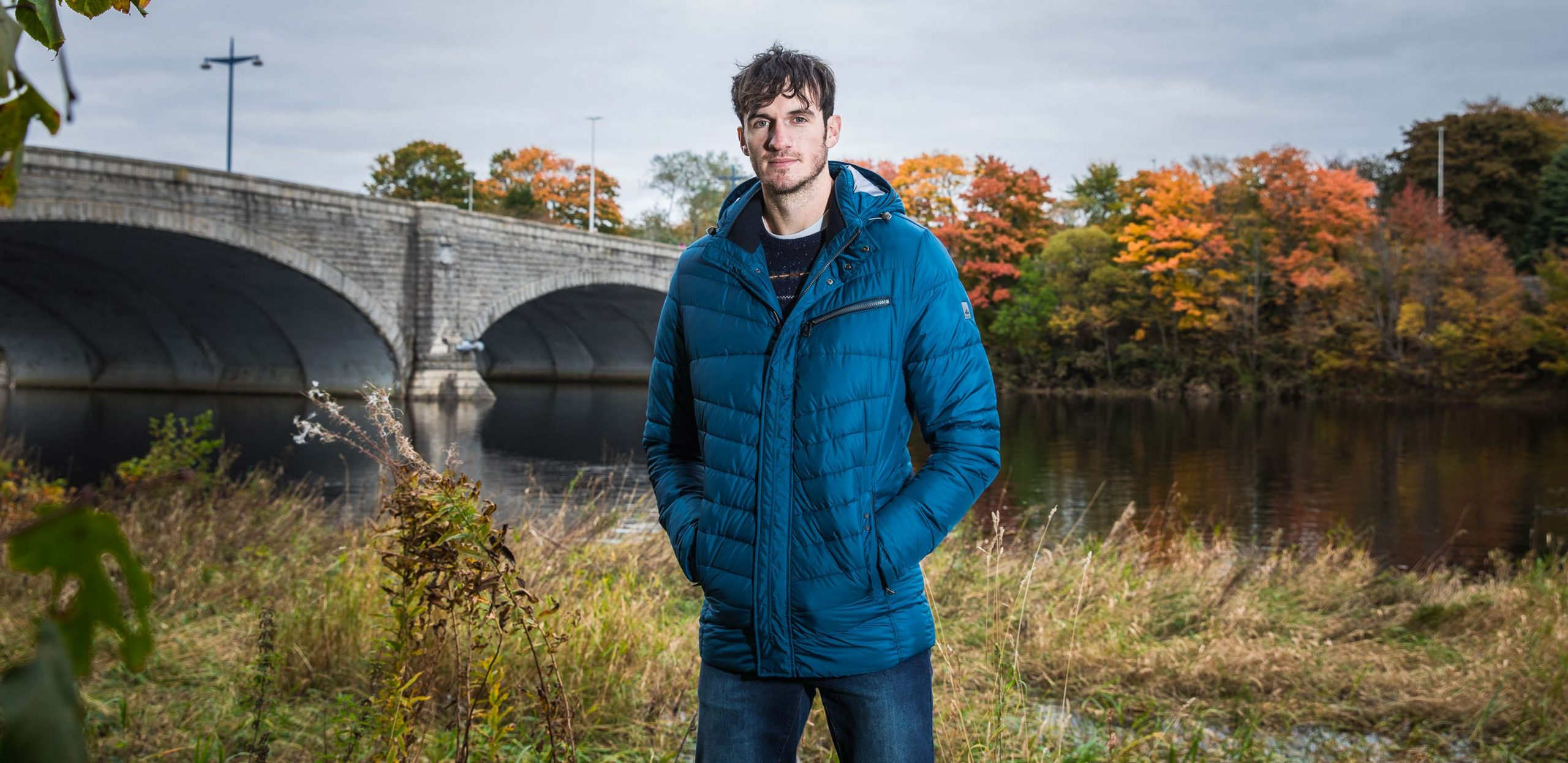 "Model is 6'11""/211CM wearing an LT Cabano Tall Lightweight Chevron Jacket in Royal Blue"