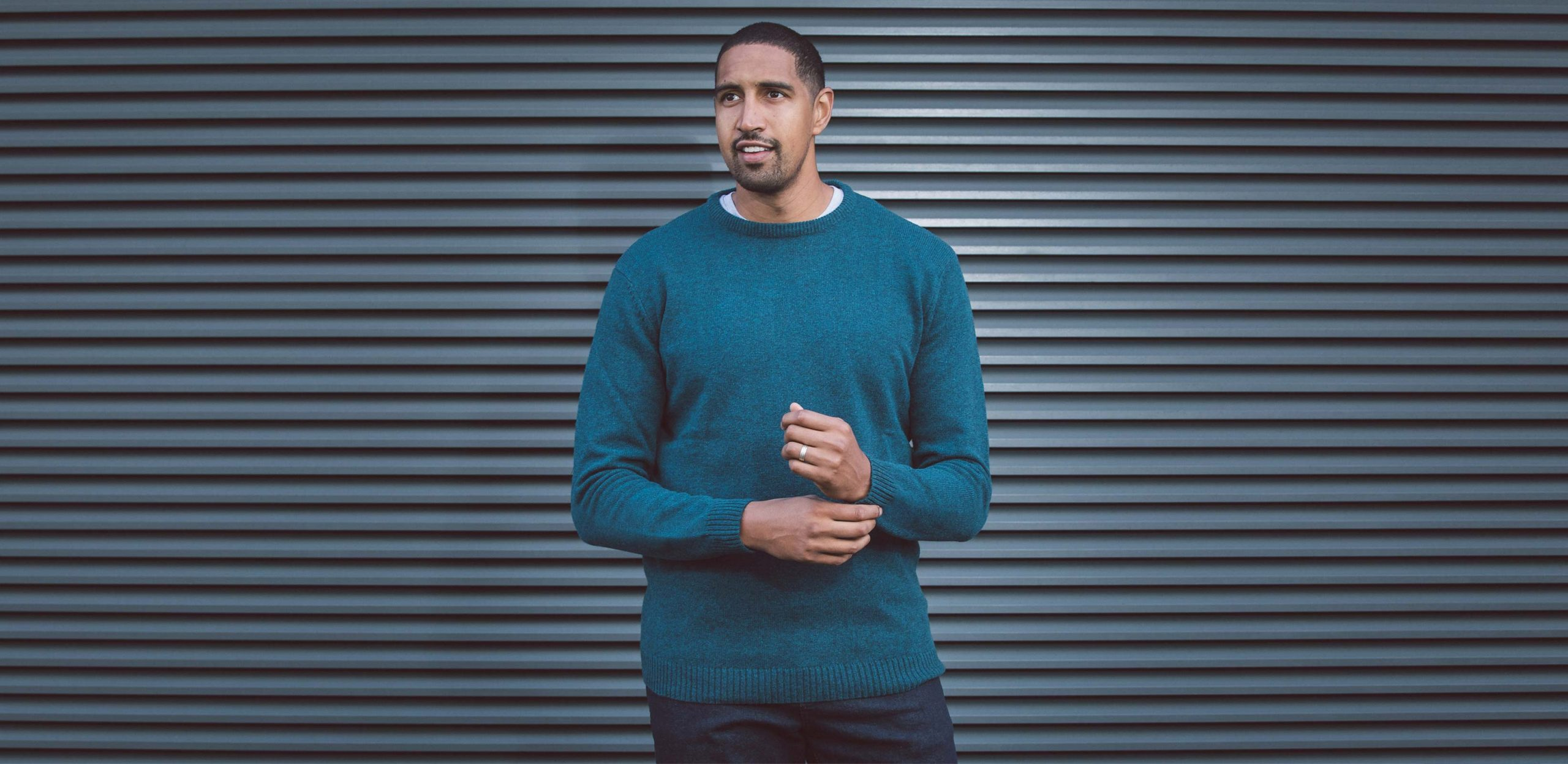 "Model is 6'10""/208CM wearing a Teal coloured size LT 2t Lambswool Crew Neck Jumper.⠀"