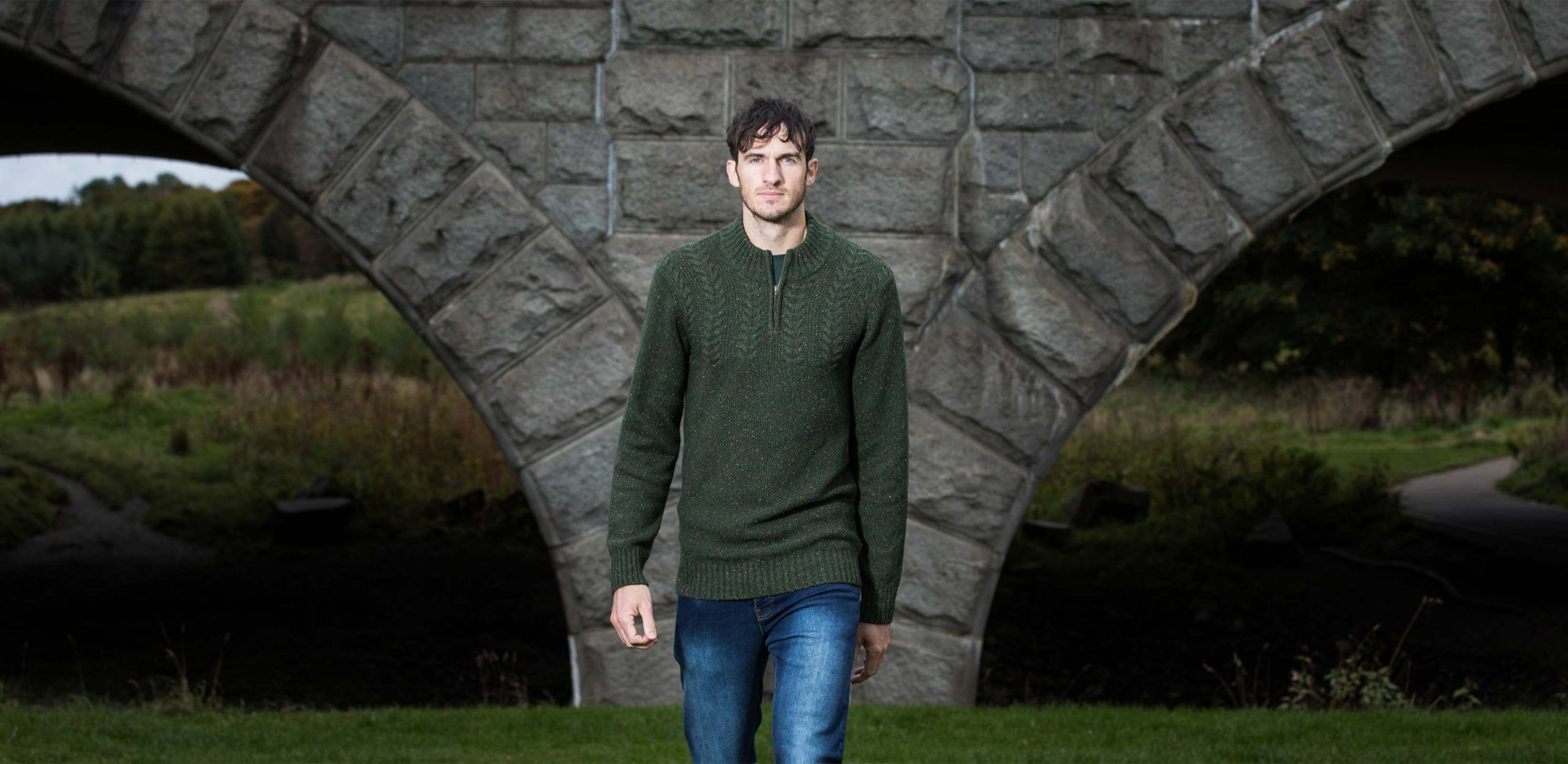 """Model is 6'11""""/211CM wearing a size LT Forest Green coloured 2t Tall Cable Knit Quarter Zip Jumper."""
