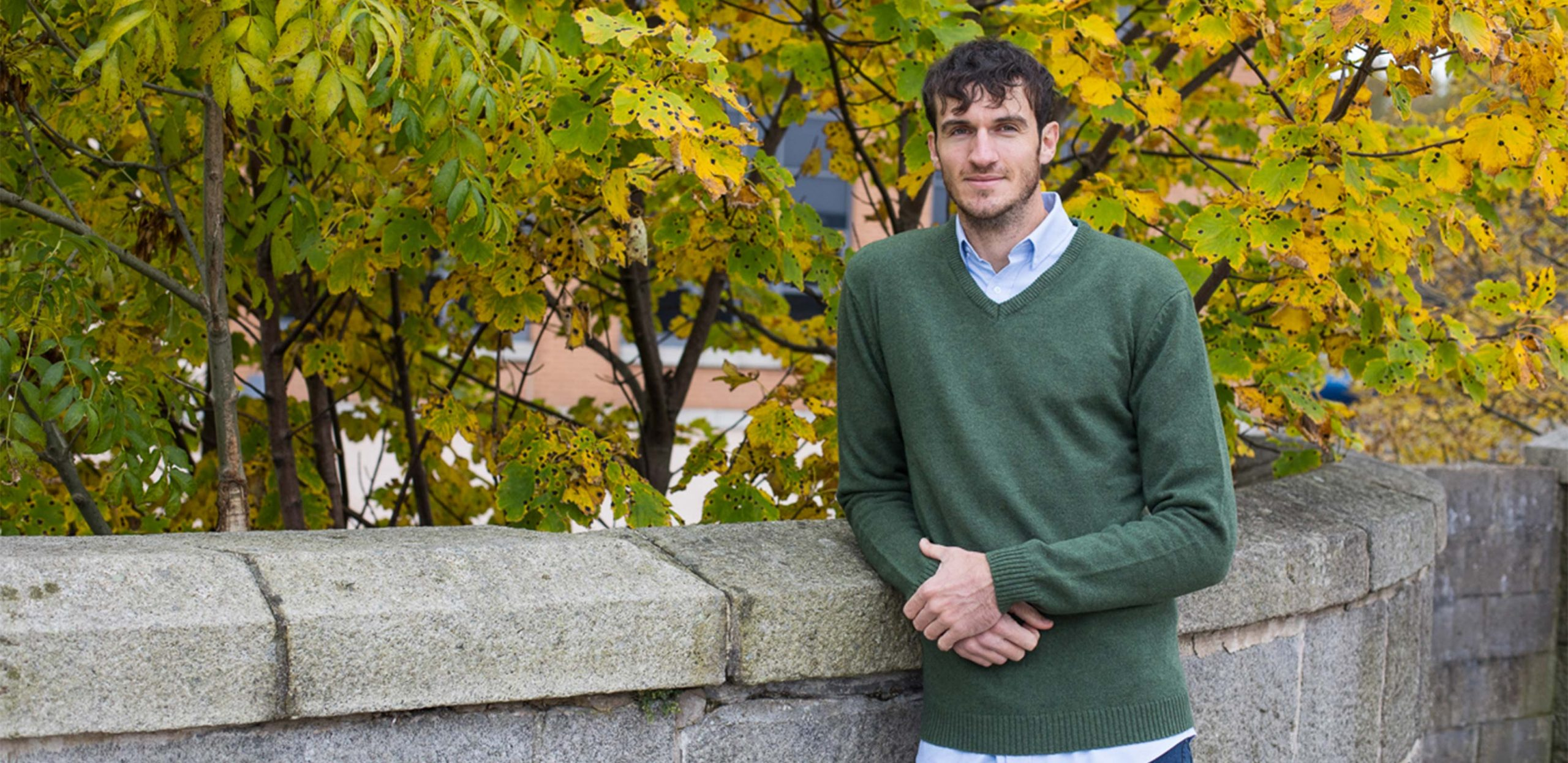 """Model is 6'11""""/211CM wearing a khaki coloured size LT 2t Lambswool V-Neck Sweater.⠀"""