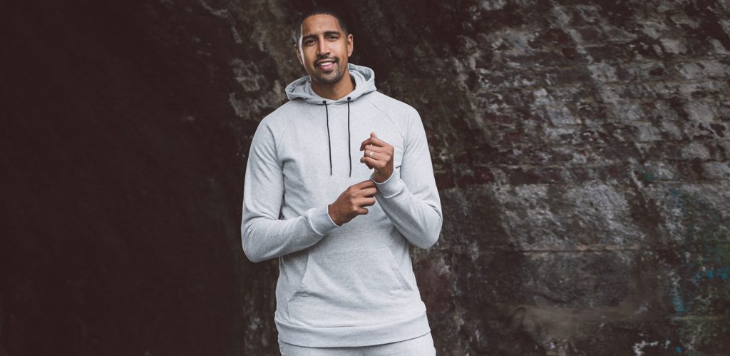 """Model is 6'10""""/208CM wearing a Heather Grey coloured size XLT 2t Riley Pullover Hoodie.⠀"""