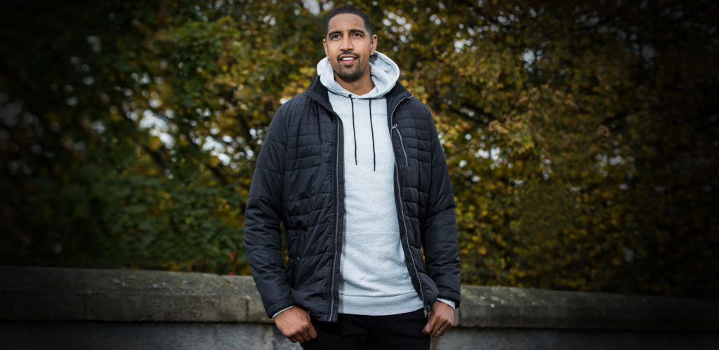 """Model is 6'10""""/208CM wearing a Heather Grey coloured size XLT 2t Riley Pullover Hoodie with a size XLT Cabano Tall Tech Down in Black.⠀"""
