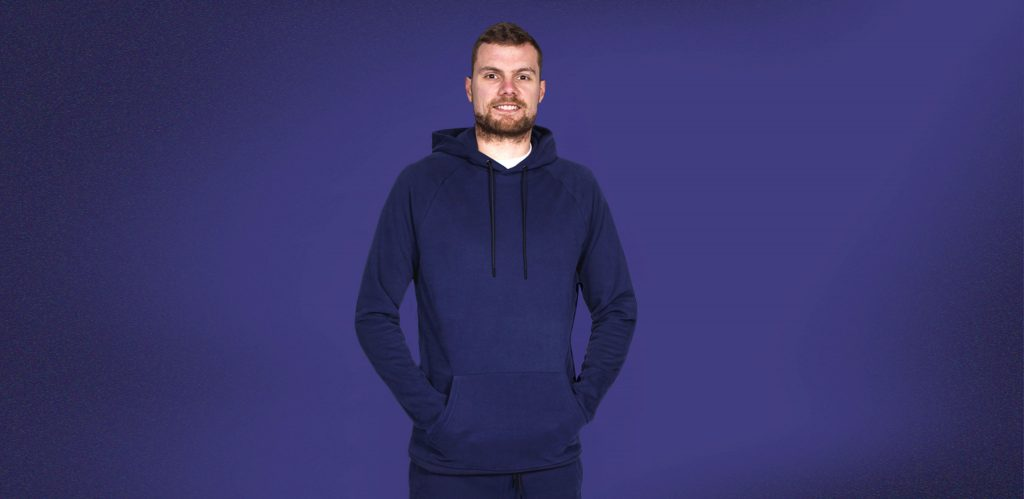 """Model is 6'9""""(206cm) & wearing a size LT Navy coloured 2t Riley Pullover Hoodie."""